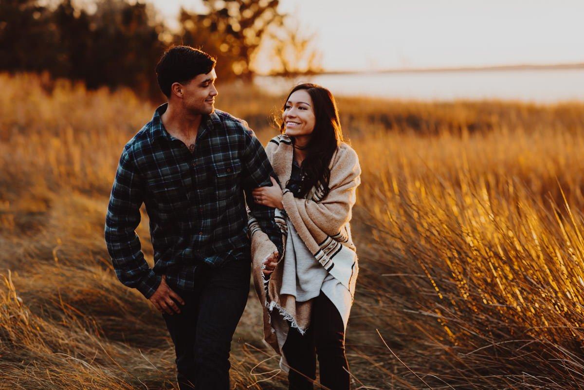 engaged couple hugs at sunset on the oregon coast during their engagement photoshoot