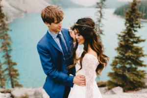 Bride and groom embrace at Moraine Lake