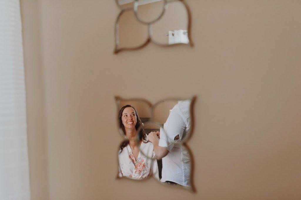 reflection of bride in mirror before wedding ceremony