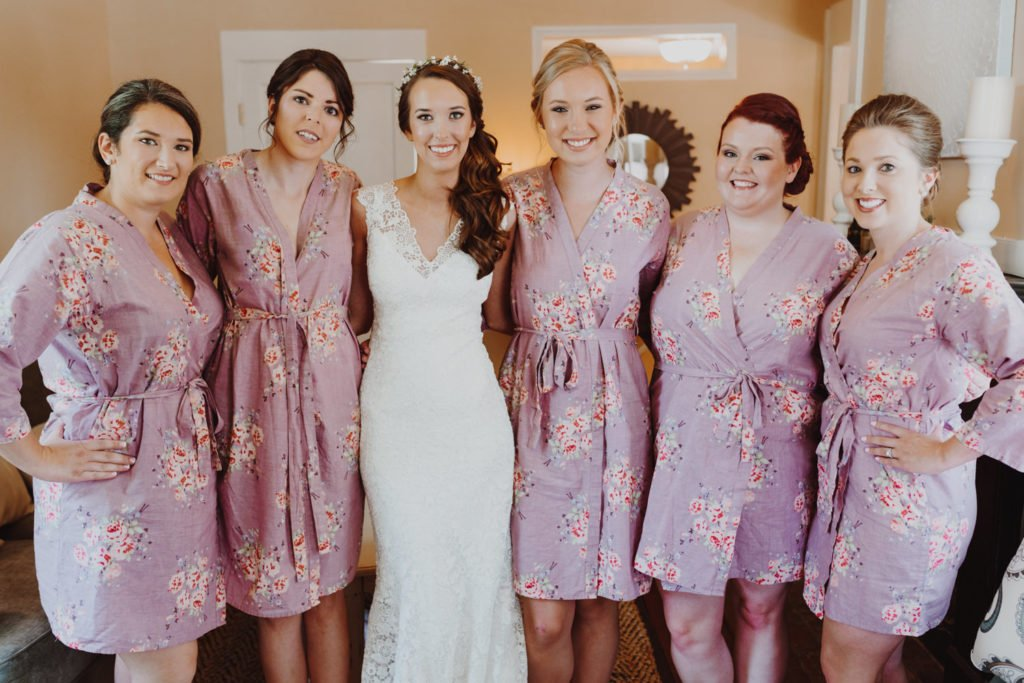 Bride and bridesmaids group photo while getting ready