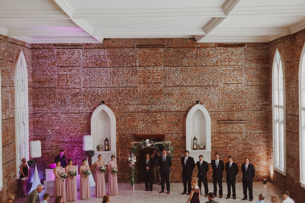 Bridal party watches bride walk down the aisle