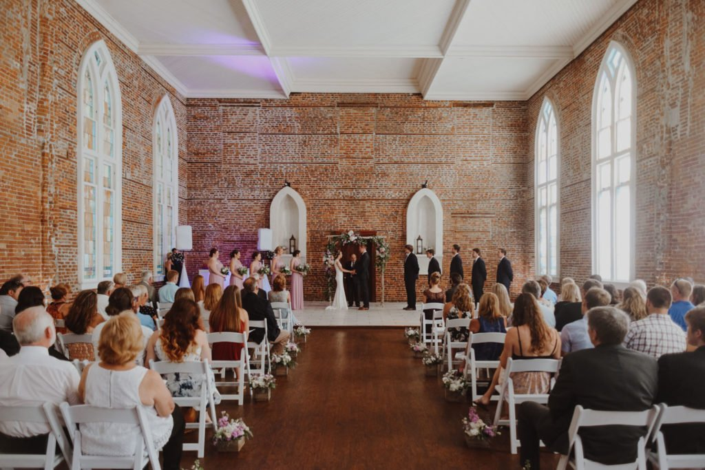 wide shot of wedding in exposed brick building