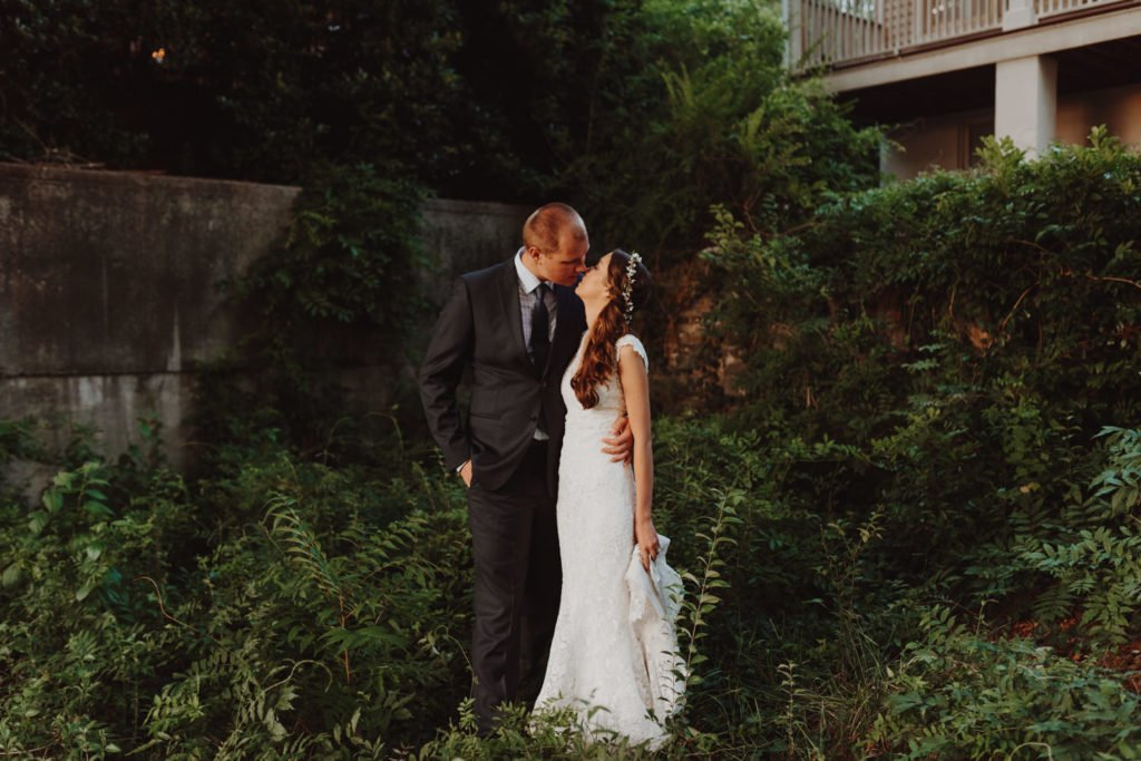 Bride and groom portraits in downtown Portland Oregon ivy covered garden