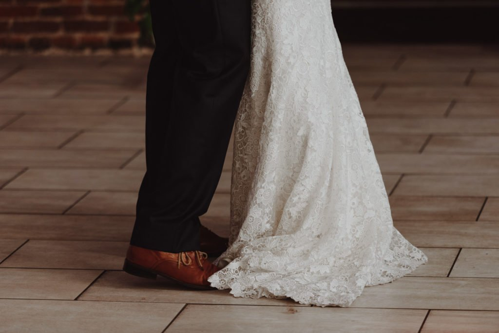 Bride and groom first dance in exposed brick building