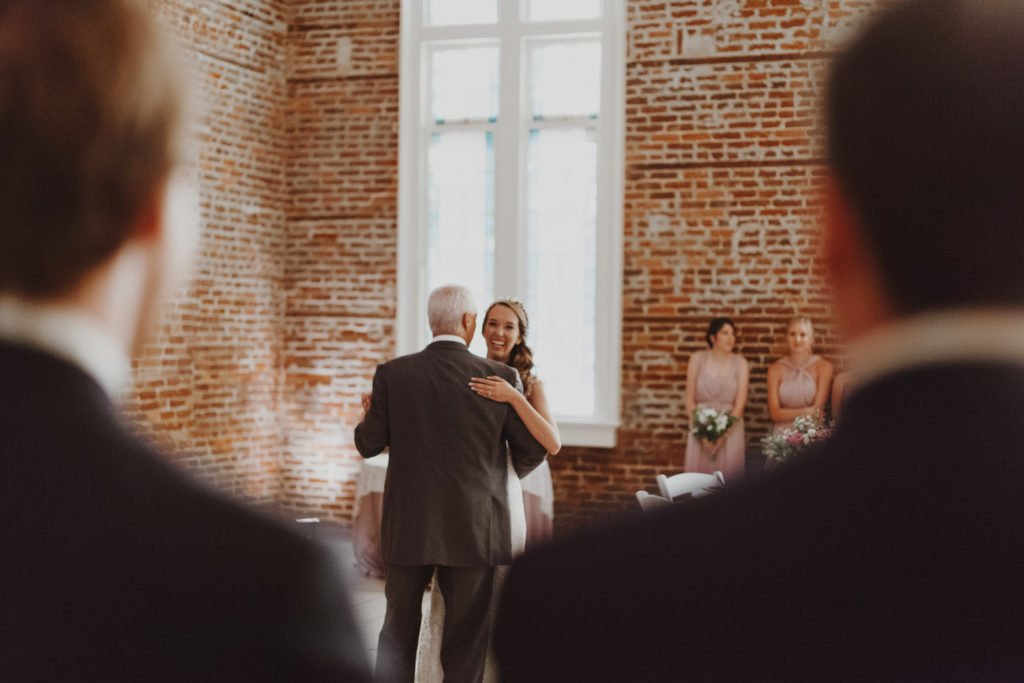 Father daughter dance in exposed brick building during a downtown Portland Oregon wedding