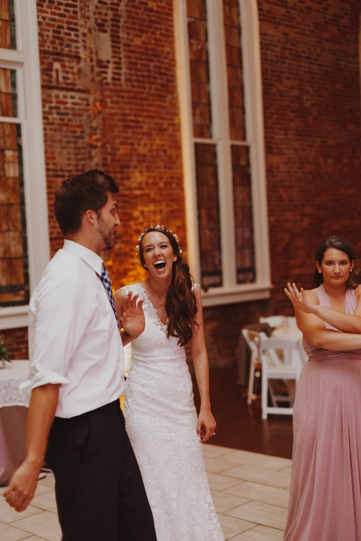 Bride laughs on the dance floor during her Portland Oregon wedding