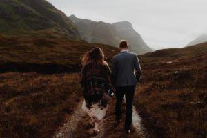 Bride and Groom walk during Glencoe Scotland Wedding