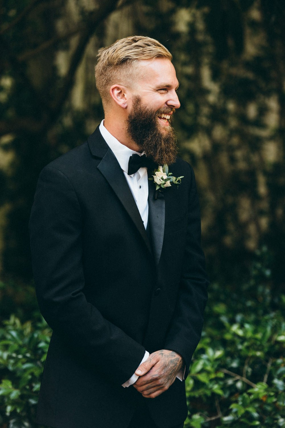 Groom laughing during Portland wedding ceremony