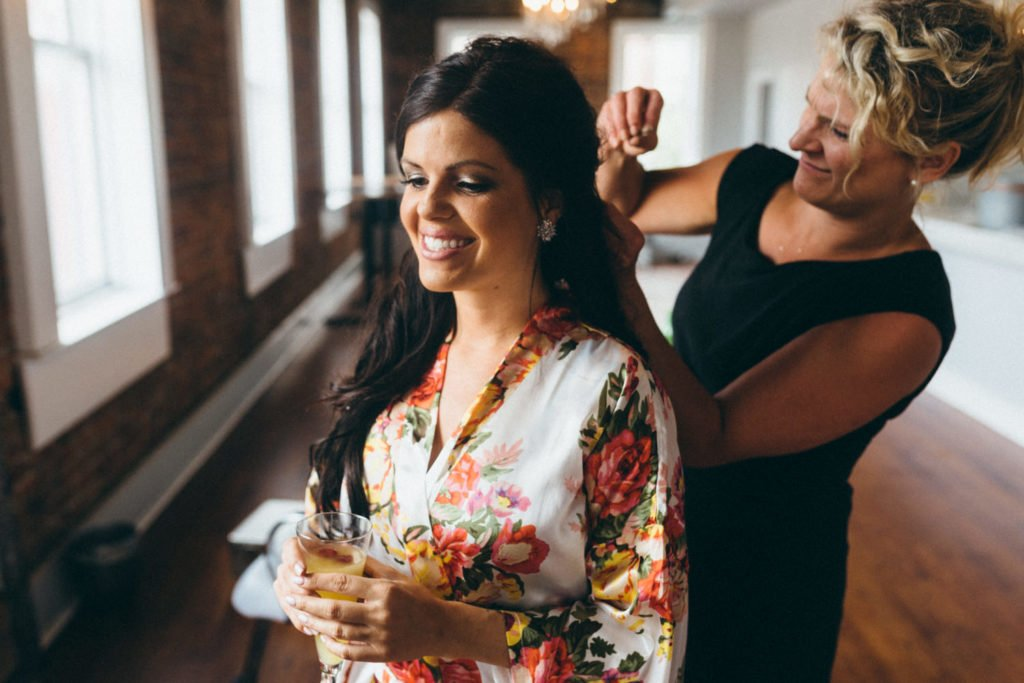 Bride getting her hair done before her Portland Oregon wedding ceremony