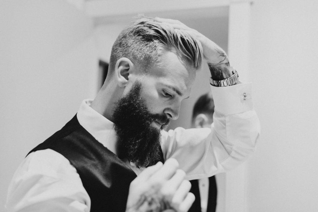 Groom getting ready before wedding