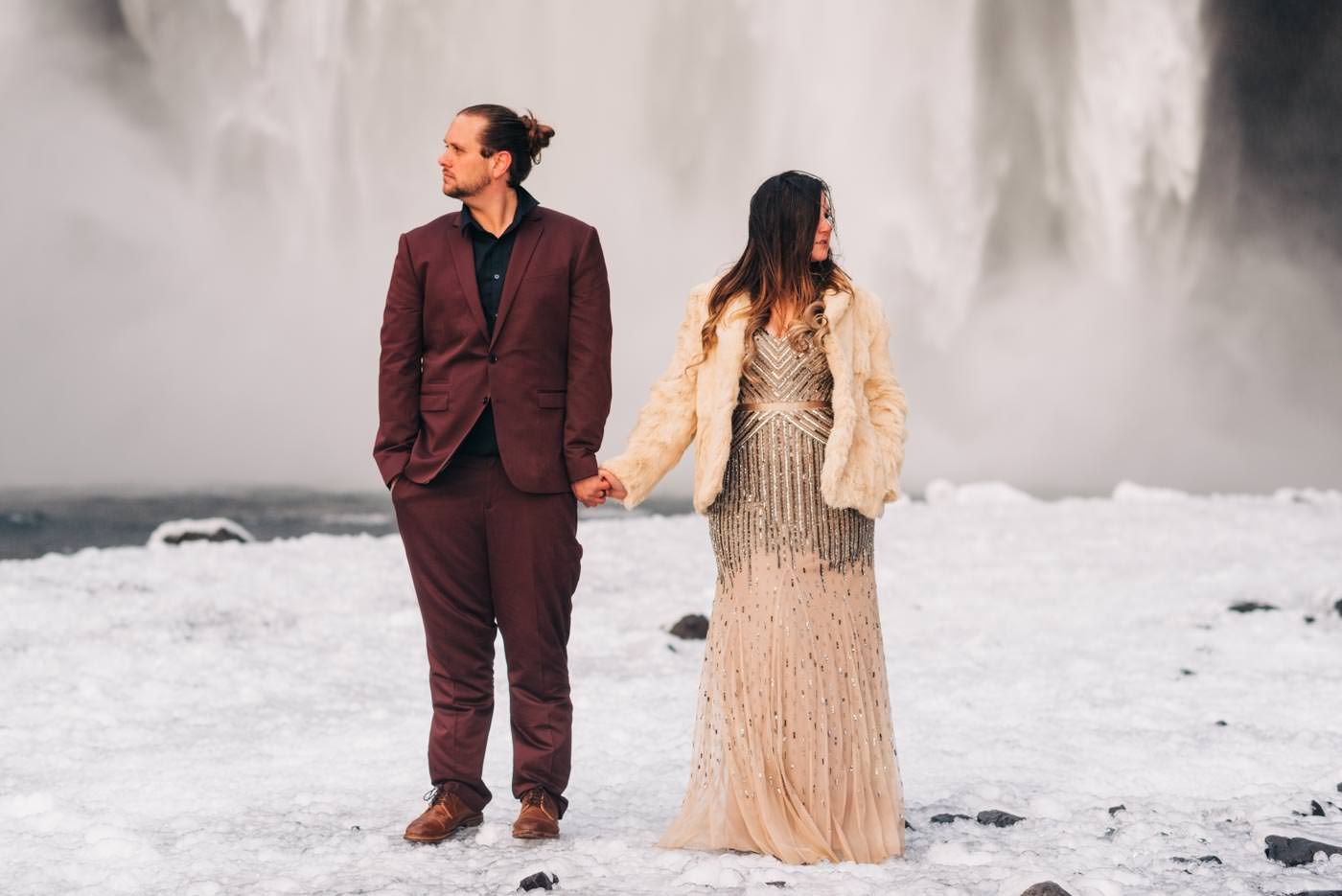 trendy Iceland Elopement Bride and Groom at skogafoss