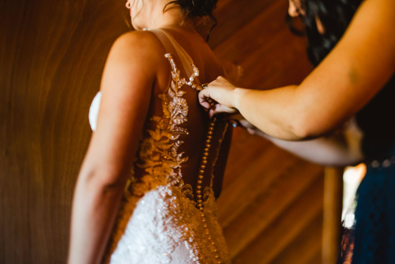 Cooper Spur Wedding bride putting on wedding dress