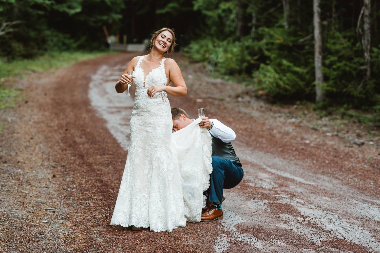 Cooper Spur Wedding groom fixing brides wedding dress