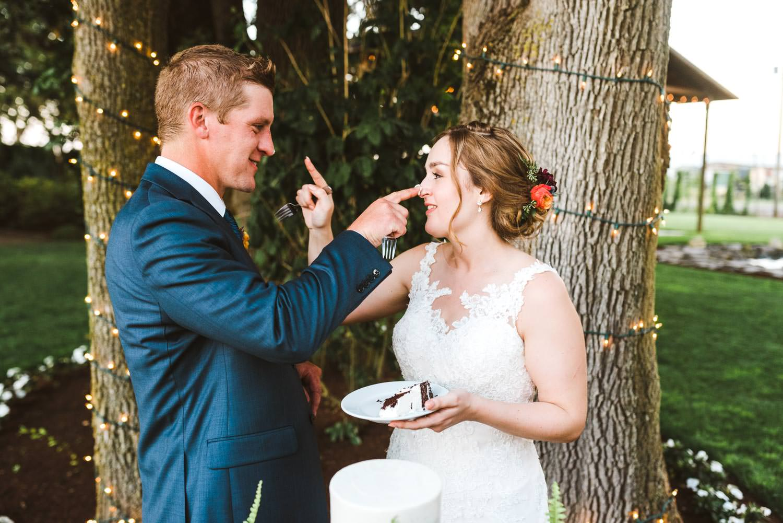 Wilmes Hops Farm Wedding Bride and Groom cake cutting